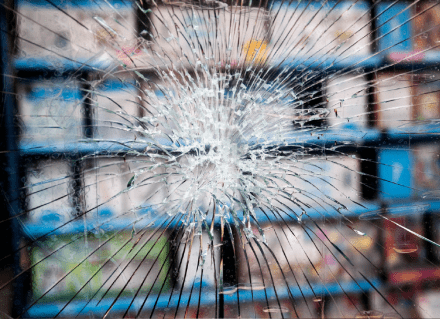 Broken glass in front of electronics store