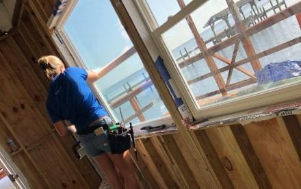 Woman installing window tint