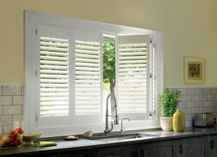 Plantation shutters over kitchen sink