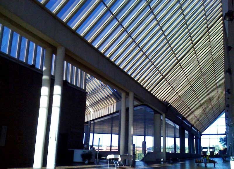 Government building with slatted glass hip roof