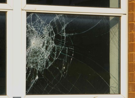 Shattered glass in a 4-panel window pane
